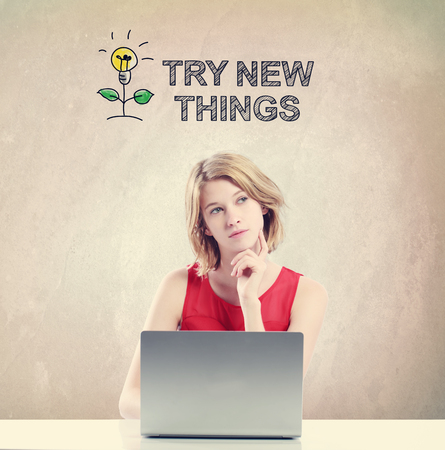 try: Try New Things concept with young woman working on a laptop