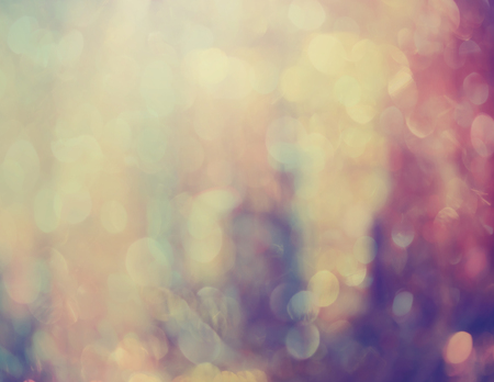 Abstract ethereal soft pink and violet background with sparkling bokeh of defocused lights in a dreamy background