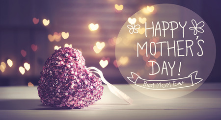 mother: Happy Mothers Day message with pink heart with heart shaped lights