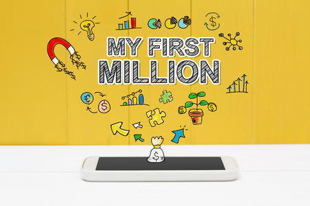 million: My First Million concept with smartphone on yellow wooden background