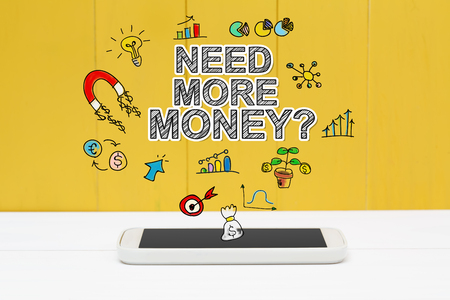 more money: Need More Money concept with smartphone on yellow wooden background Stock Photo