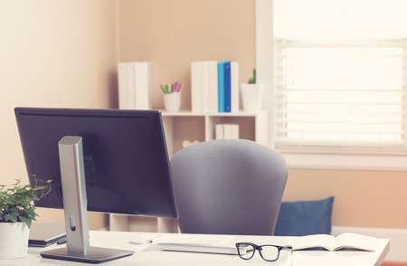office desk: Bright home office interior with desk, computer and shelves Stock Photo