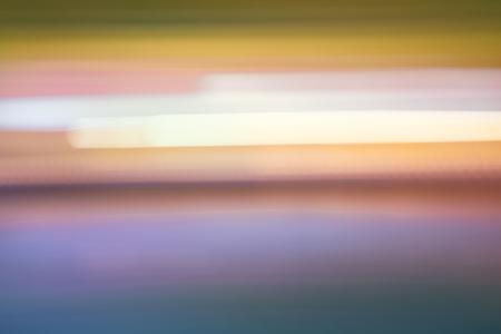 抽象的なカラフルな水平縞市ライト背景