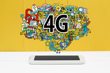 4g: 4G concept with smartphone on yellow wooden background