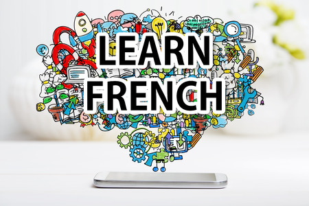 francais: Learn French concept with smartphone on white table Stock Photo