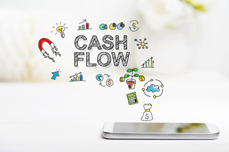 mobile banking: Cash Flow concept with smartphone on white table