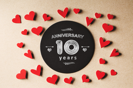 small paper: Anniversary 10 years message with handmade small paper hearts