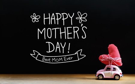 mother: Mothers Day message with miniature pink car carrying a red heart cushion