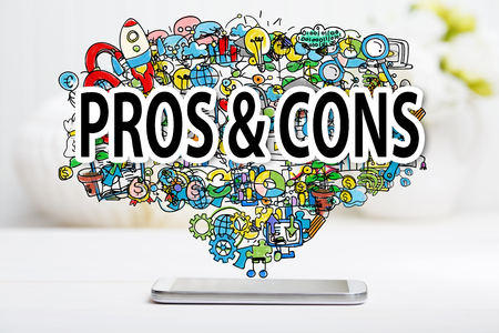 cons: Pros and Cons concept with smartphone on white table