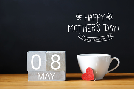 happy day: Mothers Day message with coffee cup with wooden blocks