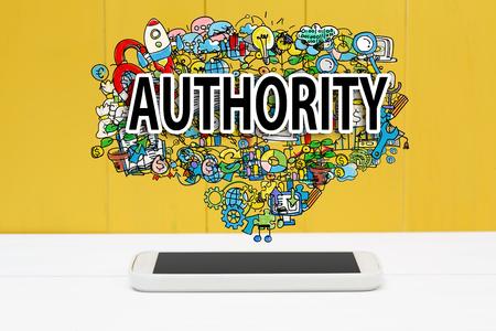 autoridad: concepto de autoridad con el teléfono inteligente en el fondo de madera de color amarillo