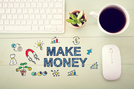 desk light: Make money concept with workstation on a light green wooden desk