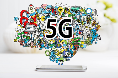5g: 5G concept with smartphone on white table