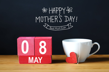 Happy Mothers Day 8 May message with coffee cup with wooden blocks