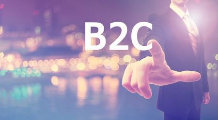 b2c: B2C concept with businessman on blurred city background Stock Photo
