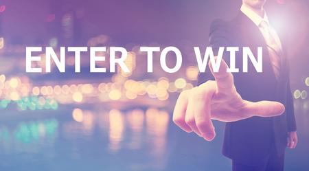 Voer To Win concept met zakenman op onscherpe achtergrond van de stad