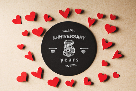 Anniversary 5 years message with handmade small paper hearts Stock Photo