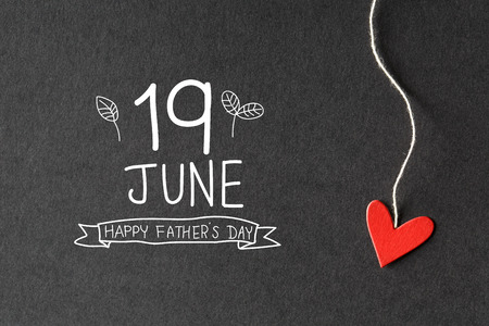 19 June Happy Fathers Day message with handmade small paper hearts Banco de Imagens