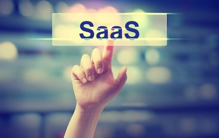 point of demand: SaaS - Software as a Service concept with hand pressing a button on blurred abstract background