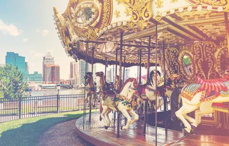 Outdoor vintage flying horse carousel in the the city 免版税图像