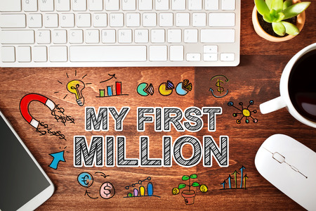 MILLION: My First Million concept with workstation on a wooden desk
