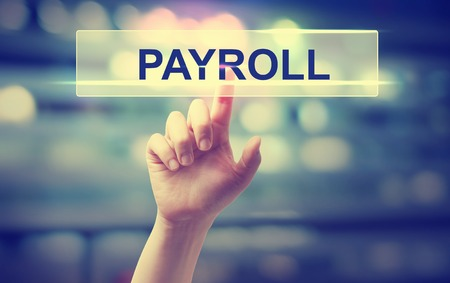 Payroll concept with hand pressing a button on blurred abstract background