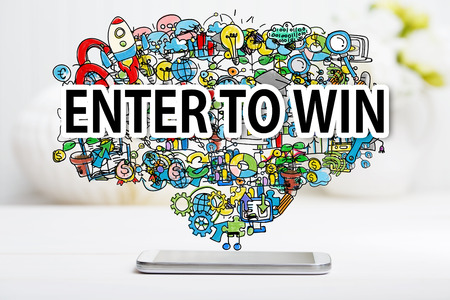 enter: Enter To Win concept with smartphone on white table
