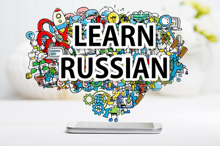 Learn Russian concept with smartphone on white table