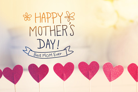 Happy Mothers Day message with small red hearts with white dishes