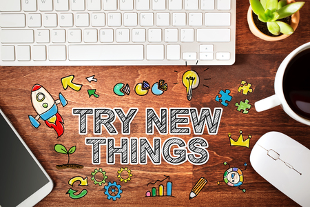try: Try New Things concept with workstation on a wooden desk Stock Photo