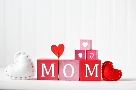 Mothers Day message on red and pink wooden blocks