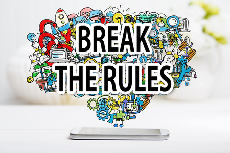 rule: Break The Rule concept with smartphone on white table