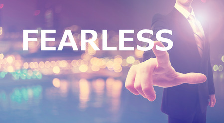 fearless: Fearless concept with businessman on blurred city background