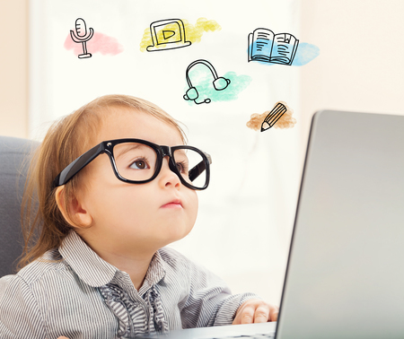 E Learning concept with toddler girl using her laptop Banco de Imagens - 54659997