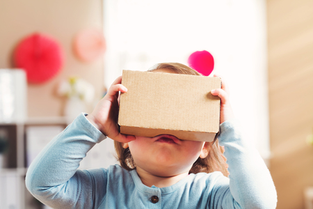 google play: Toddler girl using a new virtual reality headset