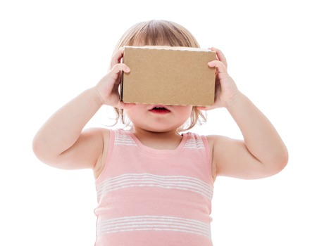 google play: Toddler girl using a new virtual reality headset isolated on white background Stock Photo