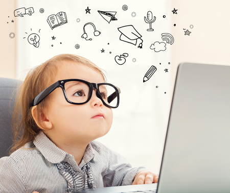 E Learning concept with toddler girl using her laptop
