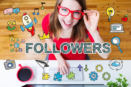 followers: Followers concept with young woman wearing red glasses in her home office