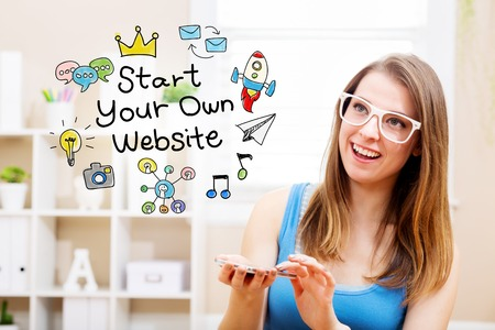 own: Start your own website concept with young woman wearing white glasses using her smartphone in her home Stock Photo