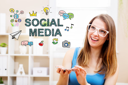 woman smartphone: Social Media concept with young woman wearing white glasses using her smartphone in her home