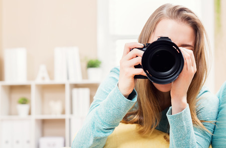 dslr: Young female photographer with DSLR camera
