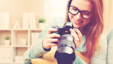 female photographer: Young female photographer with DSLR camera