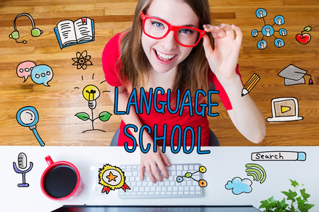 computer room: Language School concept with young woman wearing red glasses in her home office