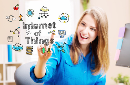 'young things': Internet of Things concept with young woman in her home office