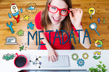 metadata: Metadata concept with young woman wearing red glasses in her home office Stock Photo