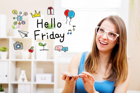 woman smartphone: Hello Friday concept with young woman wearing white glasses using her smartphone in her home Stock Photo