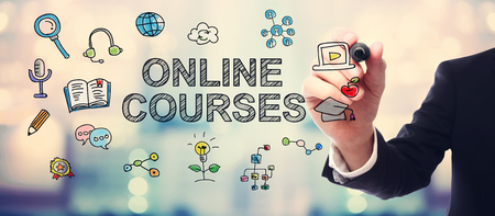 Businessman drawing Online courses concept on blurred abstract background