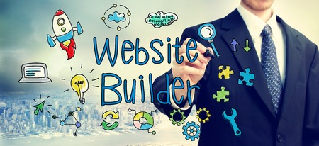 website words: Businessman drawing Website Builder concept above the city