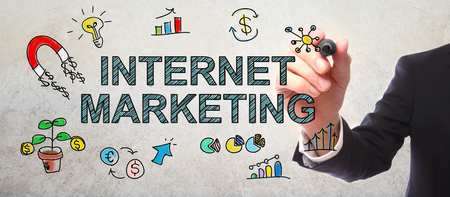 digital media: Businessman drawing Internet Marketing concept with a marker Stock Photo