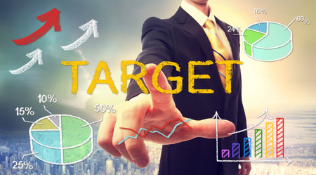 multiple targets: Target concept with businessman and graphs and arrows Stock Photo
